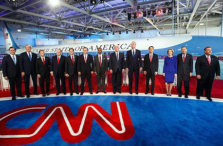 """עימות המועמדים ל מפלגה הרפובליקאית בארה""""ב ב CNN קרלי פיורינה דונלד טראמפ במרכז ולימינו ג'ב בוש, צילום: בלומברג"""