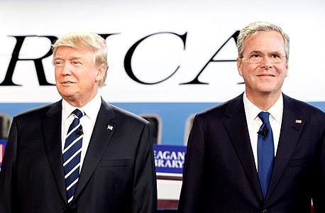 """מימין ג'ב בוש ו דונלד טראמפ בעימות של המפלגה הרפובליקאית בחירות ארה""""ב, צילום: בלומברג"""