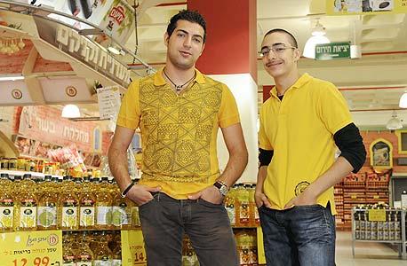 משמאל סמיר חמוד ואחיו סמי