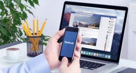 שימוש ב פייסבוק במשרד עובד משתמש בפייסבוק, צילום: שאטרסטוק