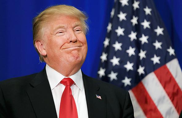 """דונלד טראמפ דגל ארה""""ב, צילום: רויטרס"""