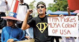 קניין רוחני תושבים בקואלה לומפור מפגינים נגד הסכמי TPP, צילום: איי אף פי