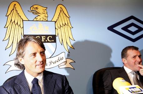 גארי קוק (מימין) ורוברטו מאנצ