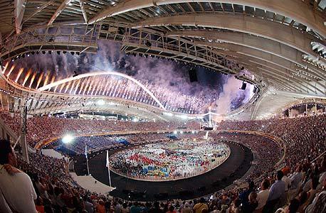 רגע השיא של העשור, טקס פתיחת אולימפיאדת אתונה ב-2004. מתקני הספורט יועמדו למכירה