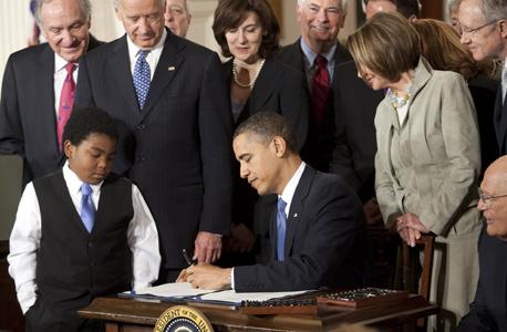 הנשיא ברק אובמה חוק הבריאות הרפורמה בבריאות, צילום: בלומברג
