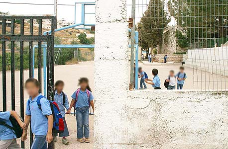 Arab Children enter their school. Photo: Amit Shabi