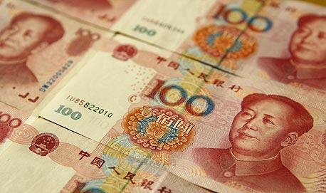 משחררים את הרצועה: סין תרשה סחר חופשי ביואן באזור הסחר בשנגחאי