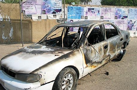 מכונית שרופה בבגדד לאחר תקרית במהלכה הרגו אנשי בלקווטר 9 אזרחים