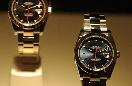 שעונים, צילום: בלומברג