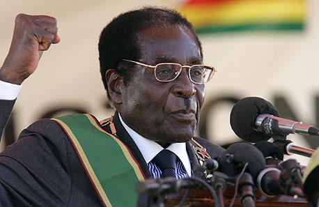 מוגאבה. סיבת המעצר: צפייה ב-DVD מהפכני, צילום: בלומברג