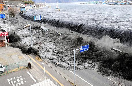 צונאמי ביפן (ארכיון), צילום: אי פי איי