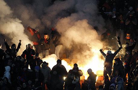 """אוהדים של צסק""""א מוסקבה, צילום: רויטרס"""