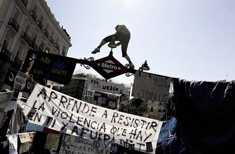 הפגנת מחאה על האבטלה בכיכר פוארטה דל סול. 50% מהמובטלים בני 45-65 מחפשים עבודה כבר יותר משנתיים, צילום: איי אף פי