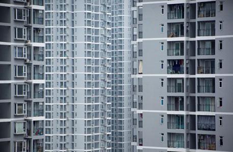בניינים אופייניים בצ'ונגצ'ינג. כשצריך לאכלס 32 מיליון בני אדם בעיר אחת, בונים קוביות