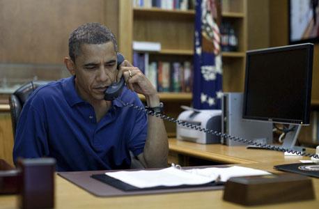 ברק אובמה טלפון, צילום: רויטרס