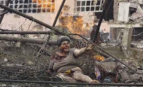תושבת העיר גורי שבגיאורגיה, שהופצצה על ידי רוסיה