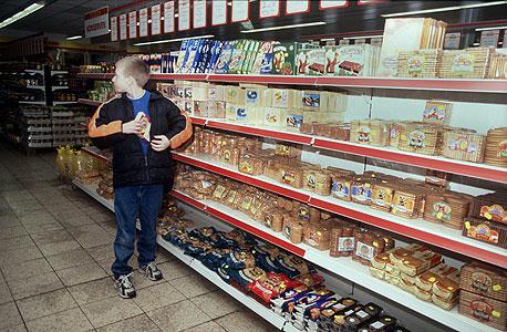 ילד גונב מסופרמרקט (ארכיון), צילום: איי אף פי