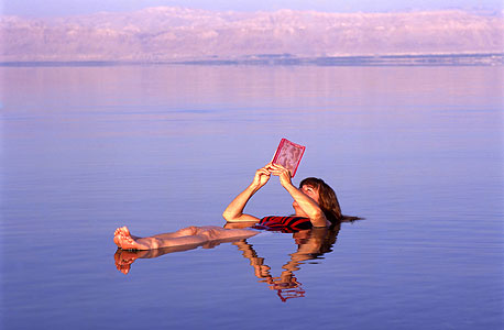 A tourist in The Dead Sea. Photo: Shutterstock