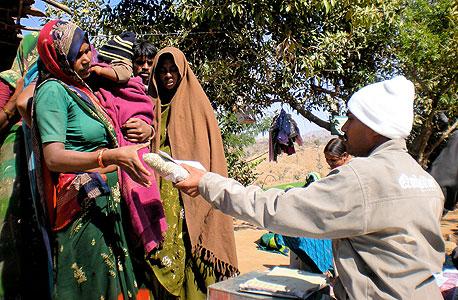 הודו: אם שחיסנה את בנה מקבלת חבילת עדשים, בניסוי לעידוד הורים לחסן את ילדיהם