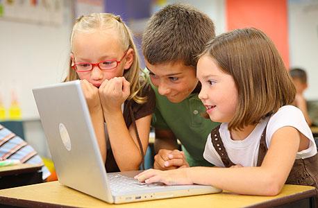 Children at a computer. Photo: Shutterstock
