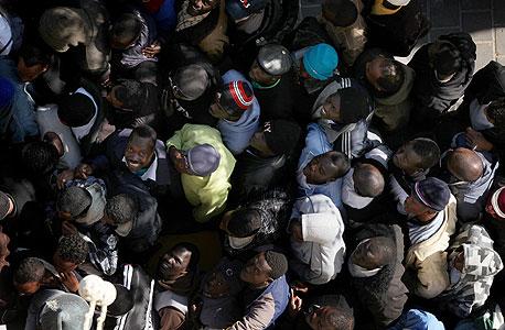 פליטים שפוקדים את בית התמחוי