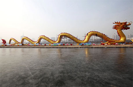 חג ספינות הדרקון בסין , צילום: אי פי אי