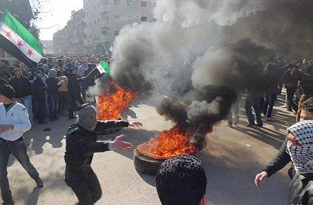 המלחמה בסוריה, העיר חומס, צילום: איי פי