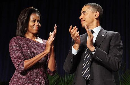 """נשיא ארה""""ב ברק אובמה ואשתו מישל אובמה, צילום: בלומברג"""