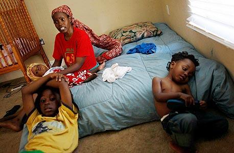 """משפחה במיאמי, 2012. """"הם חופשיים להיות עניים ולהיכשל"""""""