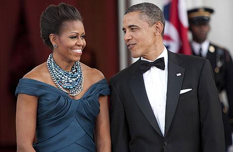 הנשיא ברק אובמה ואשתו מישל, צילום: בלומברג