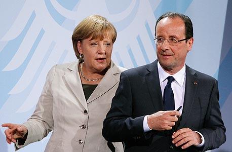 """קנצלרית גרמניה אנגלה מרקל עם נשיא צרפת פרנסואה הולנד. """"ההתאוששות באירופה אטית, אבל הרע מכל מאחורינו"""""""