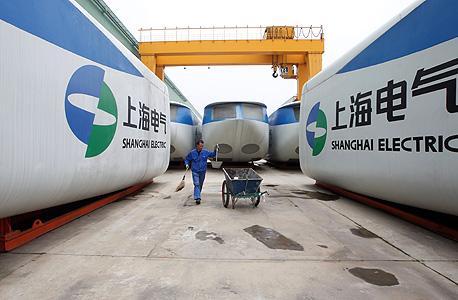 """מפעל של שנגחאי אלקטריק בסין. """"נוכחות בסין היא חובה"""", צילום: רויטרס"""