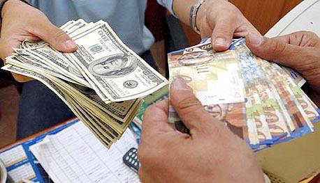 חלפן כספים, צילום: עטא עוויסאת