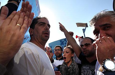 הפגנה הפגנת עובדים פלאפון, צילום: עמית שעל