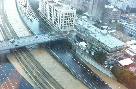 איילון מגדלי עזריאלי שטפון הצפה חורף גשם פקקים