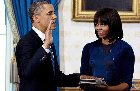 ברק אובמה מושבע השבעה, צילום: איי פי