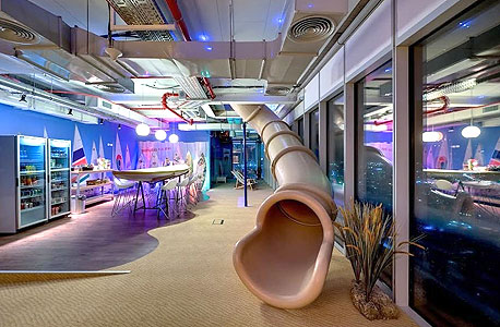 A slide leading to a furnished dining area at Google's Tel Aviv office. Photo: Itay Sikolski