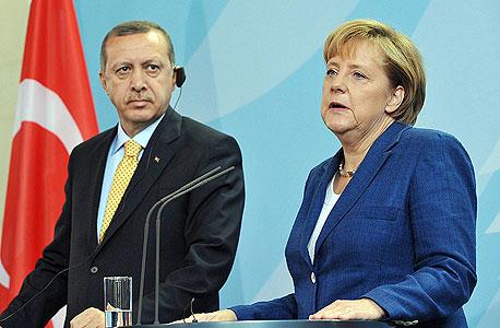 אנגלה מרקל קנצלרית גרמניה ורג'פ טאיפ ארדואן נשיא איראן, צילום: אי פי איי
