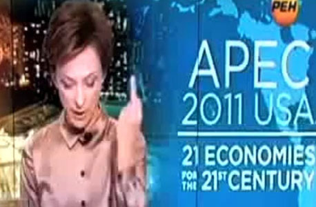 קריינית החדשות הרוסית טטיאנה לימנובה. אצבע משולשת לאובמה