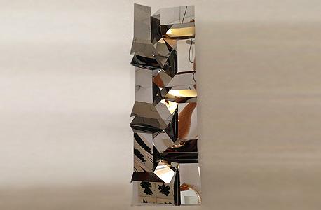 מוסף באזז 18.3.13 קיפולי מתכת אילן גריבי אוריגמי מ מתכת
