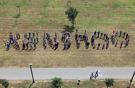 """עובדי קנשו בתס""""ח עצמאות, צילום: עמית שעל"""