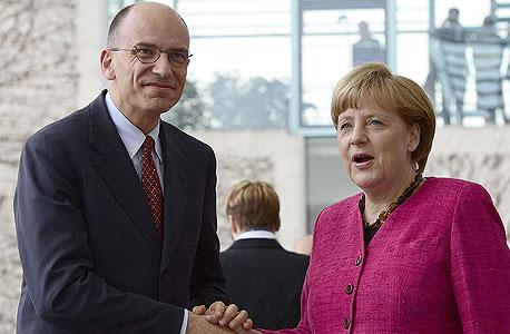 אנגלה מרקל קנצלרית גרמניה וראש ממשלת איטליה החדש אנריקו לטה, צילום: איי אף פי