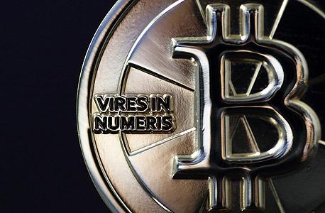 ביטקוין bitcoin מטבע וירטואלי, צילום: בלומברג
