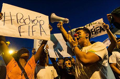 הפגנת מחאה נגד המונדיאל בברזיל, צילום: איי אף פי