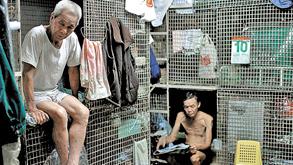 בתי כלובים בהונג קונג, צילום: אי פי איי