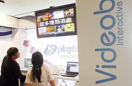 """טכנולוגיית וידיאו־בט של פלייטק בתערוכה בסינגפור. המנכ""""ל וייזר: """"אנחנו ממשיכים להתפרש"""", צילום: איי אף פי"""