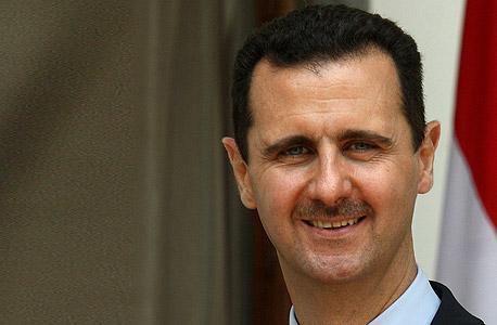 תומכיו מתנגדים לדאעש. אסד, צילום: בלומברג