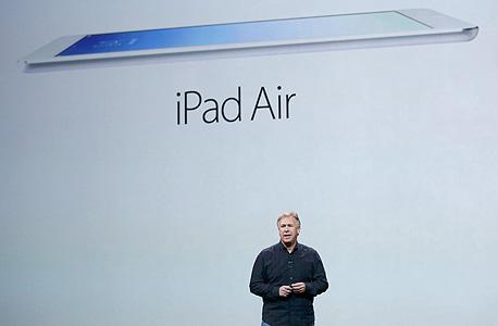 אייפד אייר ipad air חמישי אפל פיל שיר, צילום: רויטרס