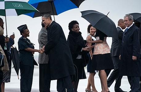 טקס האשכבה ל נלסון מנדלה הנשיא ברק אובמה הנשיא לשעבר ג'ורג' בוש, צילום: איי אף פי