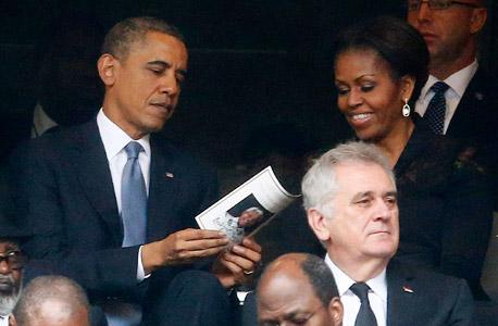 הנשיא ברק אובמה מישל אובמה טקס האשכבה ל נלסון מנדלה, צילום: רויטרס